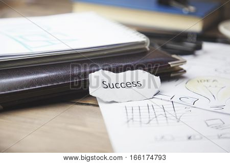 success on paper white notepad on wooden table