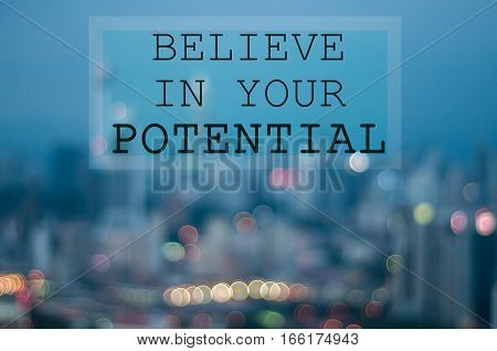 Believe In Your Potential On Blur City Background