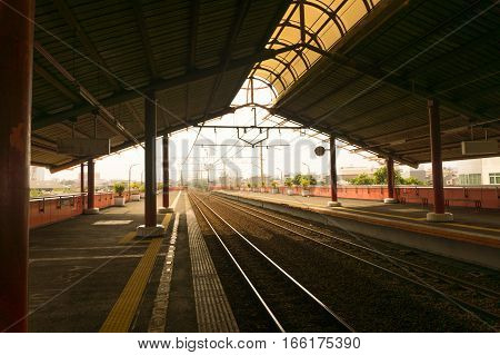 Empty station with many platforms and a sun light photo taken in Jakarta Indonesia java