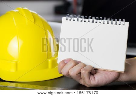Architect, Construction workers, Engineer's hand holding blank book page.