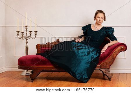 portrait of victorian woman on fainting couch