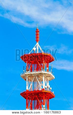 Communication towers on blue sky background .