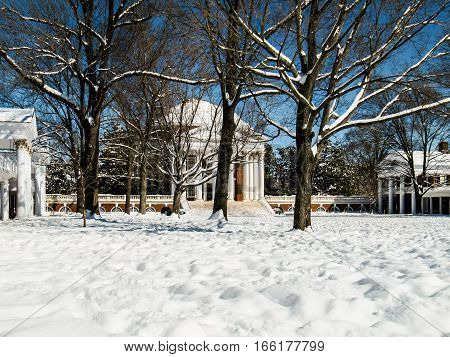 Charlottesville, USA - December 3, 2009: Snowfall on lawn of University of Virginia with Rotunda with old white dome