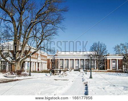 Charlottesville, USA - December 3, 2009: Alderman library and campus grounds covered in snow during winter at University of Virginia