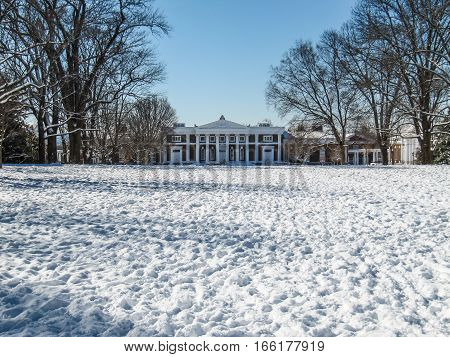 Charlottesville, USA - December 3, 2009: Snowfall on lawn of University of Virginia with Old Cabell Hall