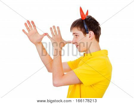 Young Man with Devil Horns gesturing Isolated on the White Background