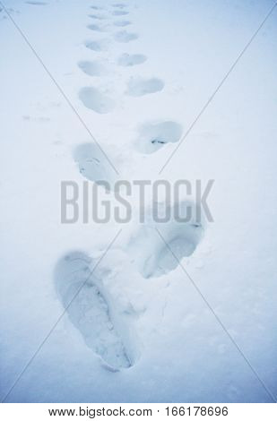Deep footprints in the snow, snowdrift texture background, winter background