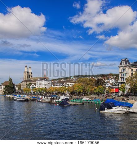Zurich, Switzerland - 13 October, 2013: the Limmat river and buildings along it, towers of the Grossmunster Cathedral. Zurich is the largest city in Switzerland and the capital of the Swiss Canton of Zurich.