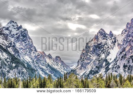 Grand Teton mountains in Wyoming national park with cloudy stormy sky