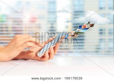 Cloud computing concept. Sending pictures to cloud.