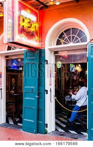 New Orleans, USA - July 8, 2015: A local musician plays guitar in a bar called Heat on Bourbon Street at French Quarter in Louisiana