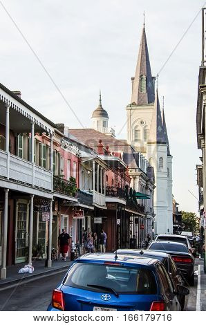 New Orleans, USA - July 8, 2015: St Louis Cathedral with old town buildings and street