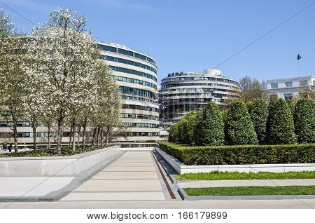 Washington DC, USA - April 12, 2015: Watergate residential building with cherry blossom flowers in spring and park