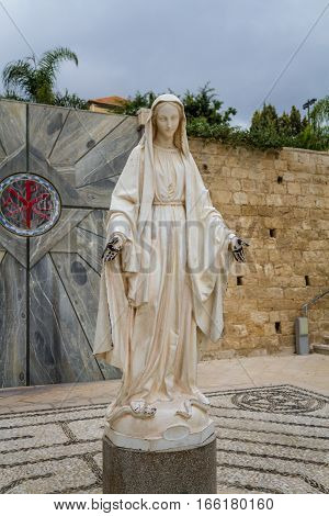 NAZARETH ISRAEL - DECEMBER 11: Statue of Virgin Mary in courtyard of the Basilica of the Annunciation or Church of the Annunciation in Nazareth Israel on December 11 2016
