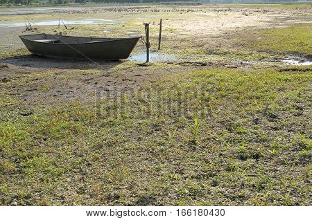 drought in the hot summer. Dried river and rest on land Boat