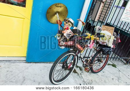 New Orleans, Louisiana - July 10, 2015: Bicycle decorated with skull and many other items