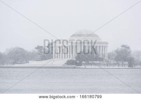 Thomas Jefferson Memorial building exterior during winter blizzard snow storm