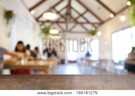 product display montage of Empty wooden table and blurred resturant or coffee shop background