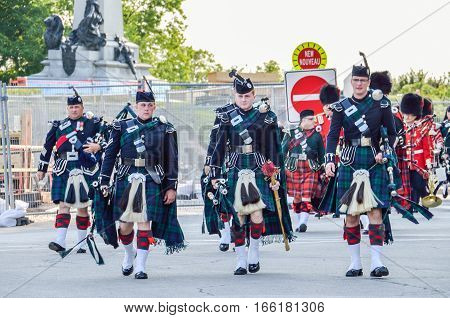 Ottawa, Canada - July 24, 2014: Canadian Soldiers with kilts walking during parade next to parliament