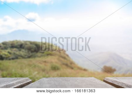 product display montage of Empty wooden table and blurred mountian view or forest background