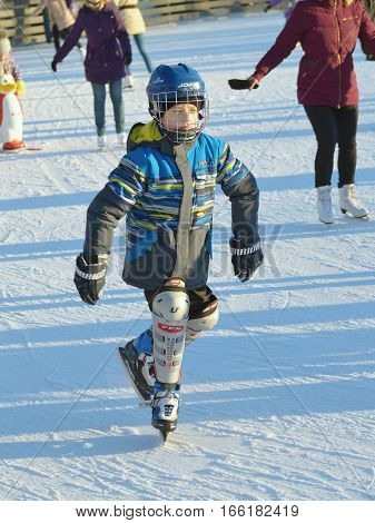 21.01.2017.Russia.Saint-Petersburg.In winter on the ice rink of the city interesting and fun.Adults and children skate.