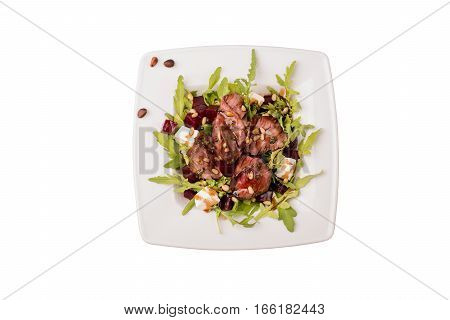 Salad with roast beef on a white background shot from the top