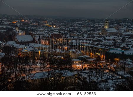 Vilnius Aerial panorama of the Old Town. Vilnius old town panorama at night. Night panorama of the Vilnius Old Town from Hill of Three Crosses, Lithuania. Vilnius winter aerial panorama of Old town.