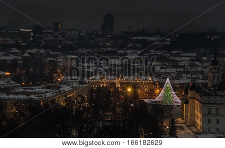 Vilnius old town panorama at night. Vilnius Aerial panorama of the Old Town. Night panorama of the Vilnius Old Town from Hill of Three Crosses, Lithuania. Vilnius winter aerial panorama of Old town.