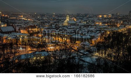 Vilnius old town panorama at night. Night panorama of the Vilnius Old Town from the Hill of Three Crosses, Lithuania. Vilnius winter aerial panorama of Old town. Aerial panorama of the Vilnius Old Town at dusk time.