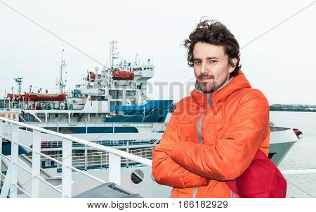 Portrait of a young successful man on the background sea landscape.