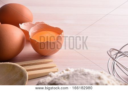 Fresh Eggs And Flour With Utensils On Wooden Bench Elevated