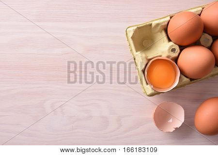 Fresh Eggs On Cartons On Wodden Bench Top