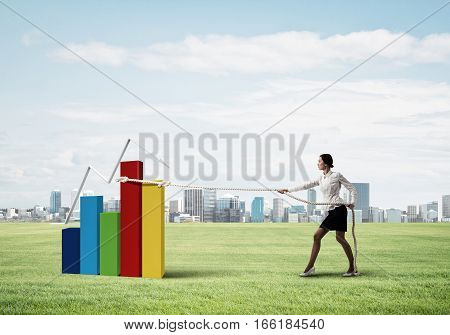 Young woman outdoors and growing graph presenting growth progress