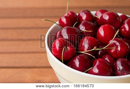Fresh, ripe, red cherries in a bowl.