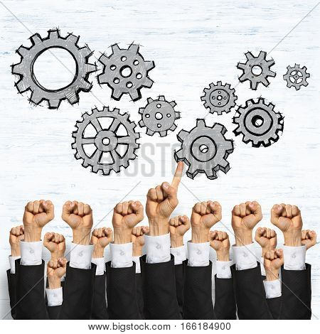 Group of hands of businesspeople showing gestures on wooden background