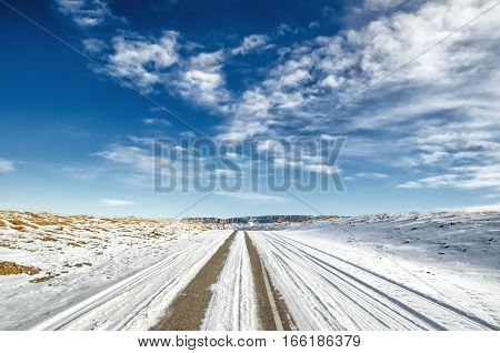 winter snow-covered road in the Caucasus mountains a wide angle