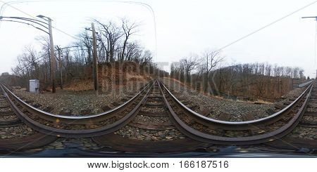 Full 360 degree spherical seamless panorama of a train tracks through the woods