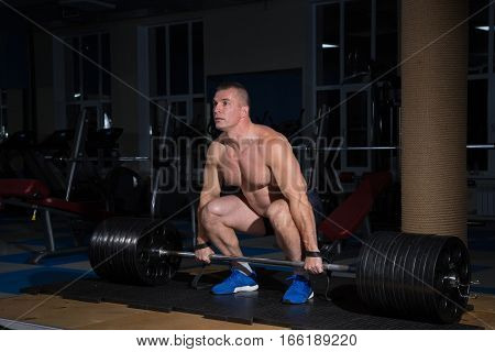 Sports background. athlete getting ready for weight lifting training.