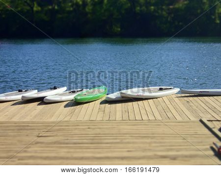 Stand up paddleboards for rent on a dock on the lake in Austin, Texas