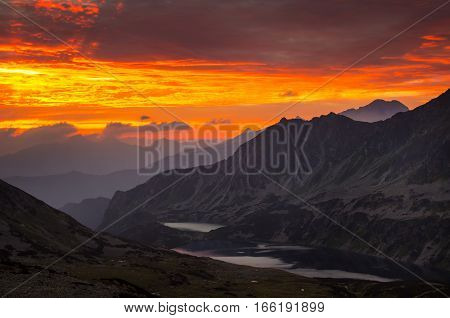 Five Lakes Valley in Tatra mountains in red sunrise light Poland