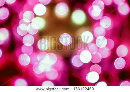 Pink festive Christmas elegant abstract background with bokeh lights.