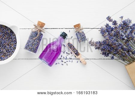 Bottle Of Essential Oil, Mortar, Lavender Flowers On White Background. Top View. Flat Lay.