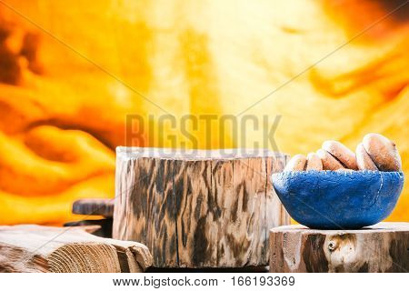 Blue bowl of cookies on rustic wood stand amid the others
