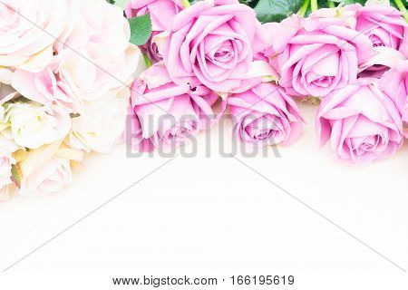 Valentines day violet and pink roses top view flat ly border