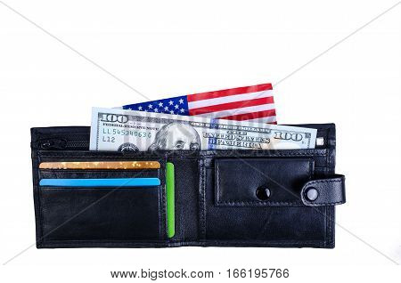 One banknote hundred dollars black purse and an American flag. On a white background. Isolated.