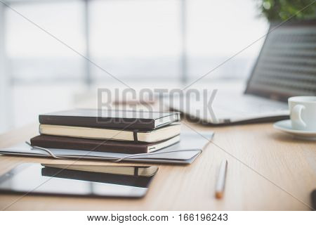 Documents on office table with pen and digital tablet as work space business concept