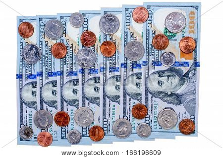 Banknotes of one hundred dollars and many coins. Flat view. Isolated.