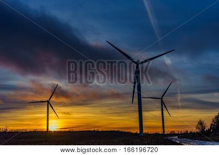 Wind turbine power generators silhouettes, Europe Estonia