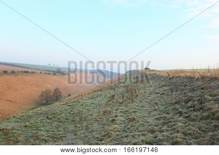 English winter landscape with frosted grasses above a scenic valley on the Yorkshire wolds in January