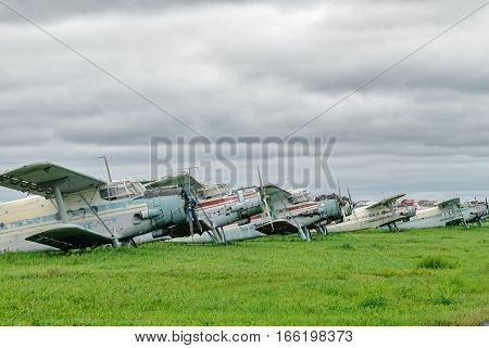 Tyumen, Russia - August 23, 2008: On visit at UTair airshow in Plehanovo heliport. AN-2 airplanes on parking lot